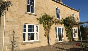 White sliding sash windows with authentic timber appearance