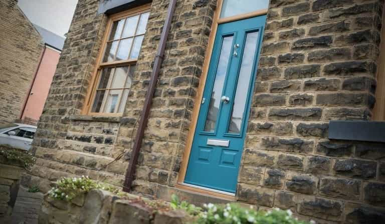 A strong and secure composite door in teal gives a modern and contemporary look Weymouth
